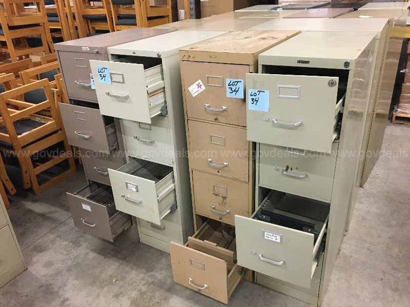 "4 Filing Cabnets 4 Drawer 25"" x 15"" x 52"" T"