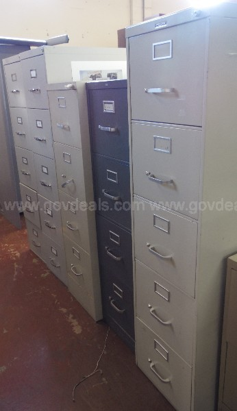 (4) Steelcase and (1) HON Filing Cabinets