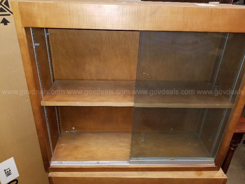 2 small shelves with sliding glass door
