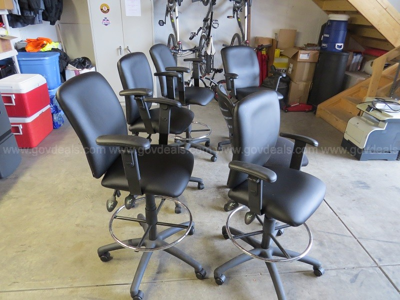 4 swivel stools and 1 office chair