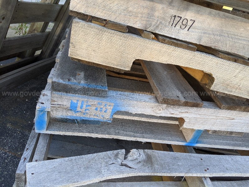 Pile of used wooden pallets