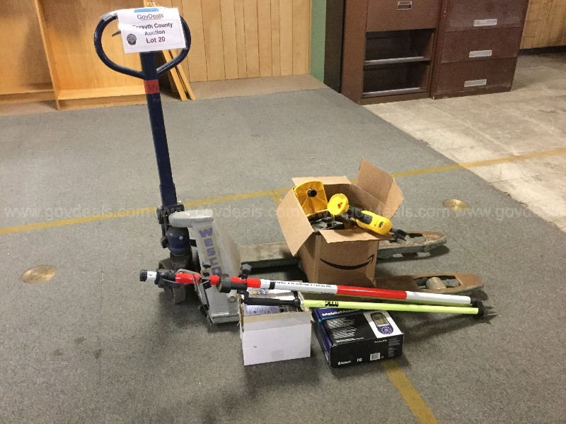 June 2020 Lot 20- Box of tools, pallet jack and surveying equipment