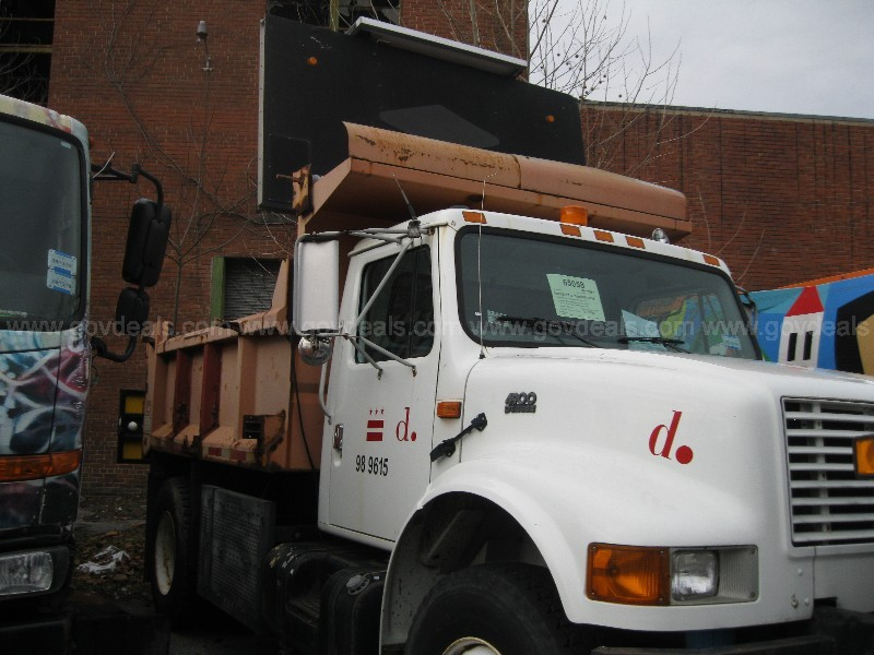 2001 International 4900 Dump Truck with sign board mounted in bed