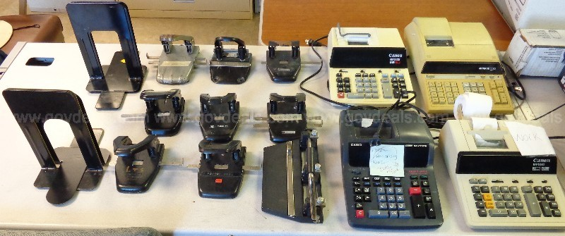 (9) METAL BOOKENDS, (8) 2- HOLE PUNCH, (4) CALCULATORS, (1) 3- HOLE PUNCH