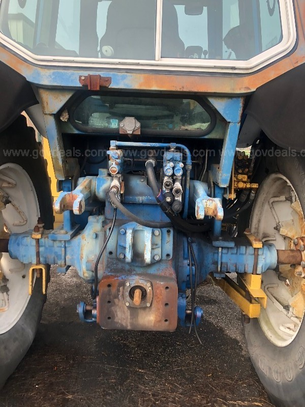 1989 Ford TW-15 tractor with mid mount 19' Tiger Boom Mower