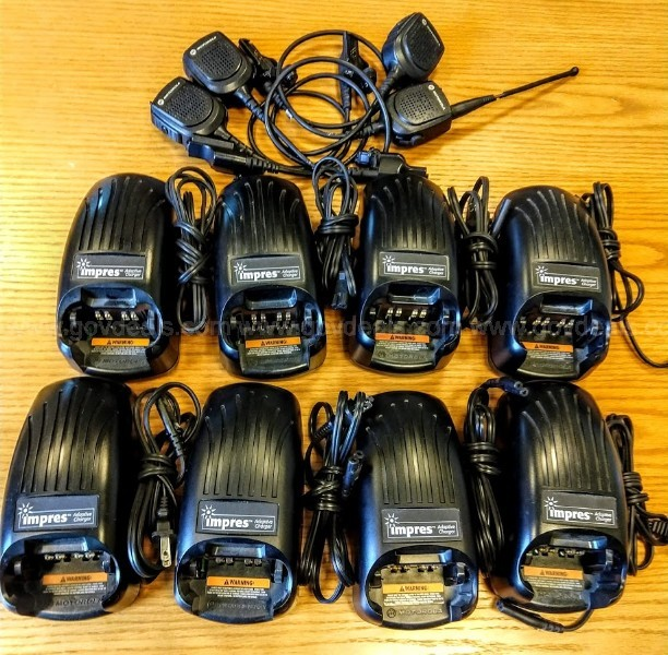 (8) Motorola Impres Single Unit Chargers and (4) Speaker Mics