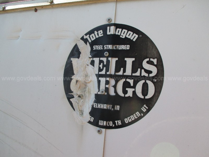 WELLS CARGO TRAILER INCLUDES CONTENTS