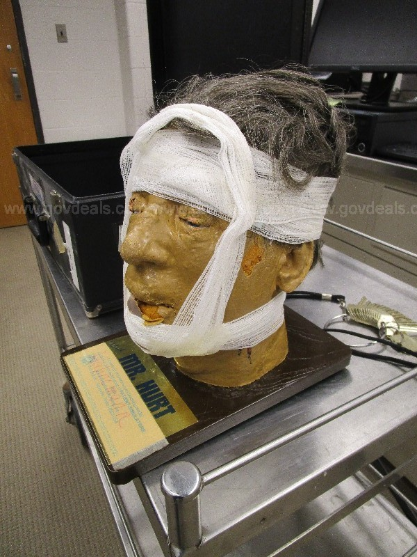 Mr. Hurt mannequin head in box