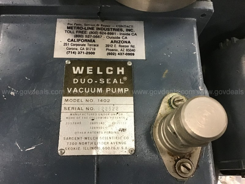 Welch duo-seal vacuum pump and a chromato-vue ultra violet light box
