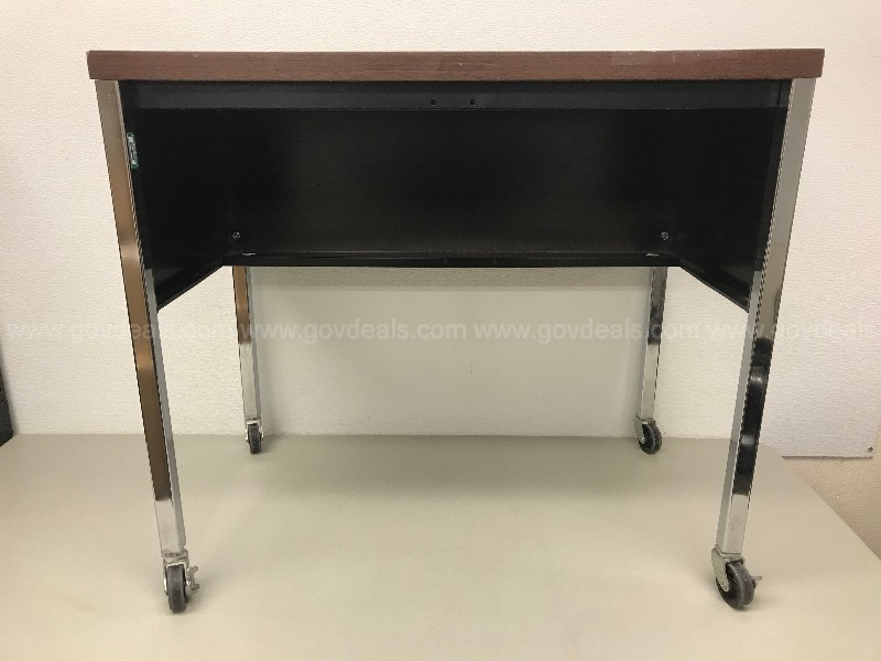 SMALL METAL TABLE ON CASTERS