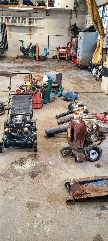 A collection of small engine and battery powered equipment.